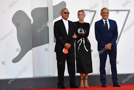 Andrei Konchalovsky (L), his wife, Russian actress Julia Vysotskaya (C) and Festival Director Alberto Barbera attend the premiere of 'Dorogie Tovarischi! (Dear Comrades!)' during the 77th annual Venice International Film Festival, in Venice, Italy, 07 September 2020. The movie is presented in the official competition 'Venezia 77' at the festival running from 02 September to 12 September. The event is the first major in-person film fest to be held in the wake of the Covid-19 coronavirus pandemic. Attendees have to follow strict safety measures like mandatory face masks indoors, temperature scanners, and socially distanced screenings to reduce the risk of infection. The public is barred from the red carpet, and big stars are expected to be largely absent this year.
