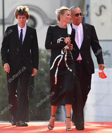 Andrei Konchalovsky (R) and his wife, Russian actress Julia Vysotskaya, and their son arrive for the premiere of 'Dorogie Tovarischi! (Dear Comrades!)' during the 77th annual Venice International Film Festival, in Venice, Italy, 07 September 2020. The movie is presented in the official competition 'Venezia 77' at the festival running from 02 September to 12 September. The event is the first major in-person film fest to be held in the wake of the Covid-19 coronavirus pandemic. Attendees have to follow strict safety measures like mandatory face masks indoors, temperature scanners, and socially distanced screenings to reduce the risk of infection. The public is barred from the red carpet, and big stars are expected to be largely absent this year.