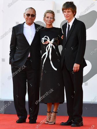 Andrei Konchalovsky (L), his wife, Russian actress Julia Vysotskaya (C), and their son arrive for the premiere of 'Dorogie Tovarischi! (Dear Comrades!)' during the 77th annual Venice International Film Festival, in Venice, Italy, 07 September 2020. The movie is presented in the official competition 'Venezia 77' at the festival running from 02 September to 12 September. The event is the first major in-person film fest to be held in the wake of the Covid-19 coronavirus pandemic. Attendees have to follow strict safety measures like mandatory face masks indoors, temperature scanners, and socially distanced screenings to reduce the risk of infection. The public is barred from the red carpet, and big stars are expected to be largely absent this year.
