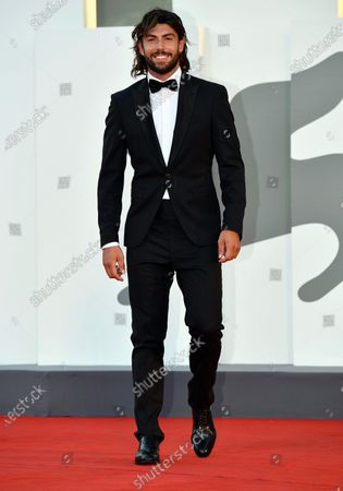 Italian cyclist Ignazio Moser arrives for the premiere 'Sniegu juz nigdy nie bedzie (Never Gonna Snow Again)' during the 77th annual Venice International Film Festival, in Venice, Italy, 07 September 2020. The movie is presented in the Official Competition 'Venezia77' at the festival running from 02 September to 12 September. The event is the first major in-person film fest to be held in the wake of the Covid-19 coronavirus pandemic. Attendees have to follow strict safety measures like mandatory face masks indoors, temperature scanners, and socially distanced screenings to reduce the risk of infection. The public is barred from the red carpet, and big stars are expected to be largely absent this year. The 77th edition of the festival runs from 02 to 12 September 2020.