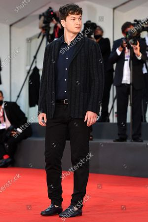 Ukrainian-born English actor/cast member Alec Utgoff arrives for the premiere 'Sniegu juz nigdy nie bedzie (Never Gonna Snow Again)' during the 77th annual Venice International Film Festival, in Venice, Italy, 07 September 2020. The movie is presented in the Official Competition 'Venezia77' at the festival running from 02 September to 12 September. The event is the first major in-person film fest to be held in the wake of the Covid-19 coronavirus pandemic. Attendees have to follow strict safety measures like mandatory face masks indoors, temperature scanners, and socially distanced screenings to reduce the risk of infection. The public is barred from the red carpet, and big stars are expected to be largely absent this year. The 77th edition of the festival runs from 02 to 12 September 2020.