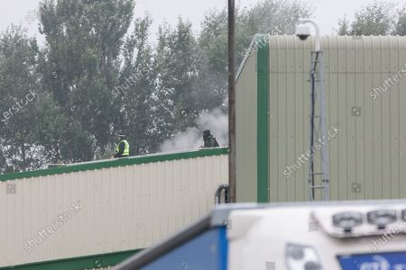 After 12 hours Police bring down an animal rights activist from the roof of the Tulip slaughterhouse in Greater Manchester