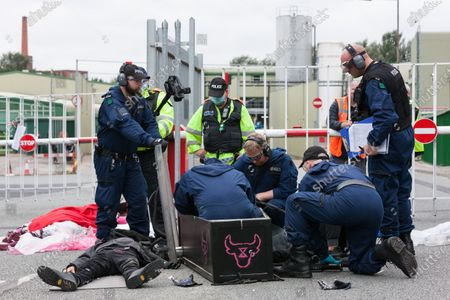 Police Special Operations free 2 animal rights activists from a coffin they had attached themselves to at the Tulip slaughterhouse in Greater Manchester
