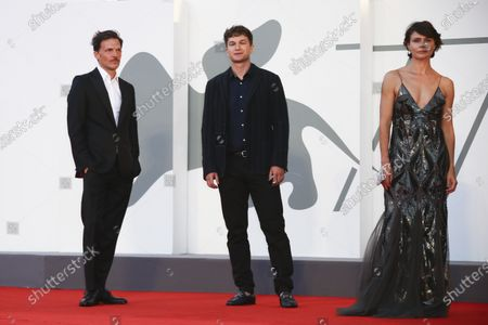 Co directors Michal Englert, left, and Malgorzata Szumowska, right, pose with actor Oleh Yutgof for photographers upon arrival at the premiere of the film 'Sniegu Juz Nigdy Nie Bedzie (Never Gonna Snow Again)' during the 77th edition of the Venice Film Festival in Venice, Italy