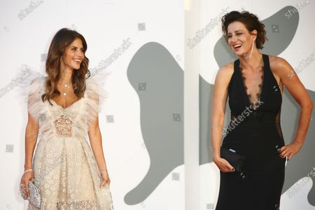 Actress Weronika Rosati, left, and Maja Ostaszewska pose for photographers upon arrival at the premiere of the film 'Sniegu Juz Nigdy Nie Bedzie (Never Gonna Snow Again)' during the 77th edition of the Venice Film Festival in Venice, Italy