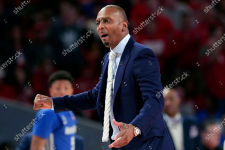 """Memphis head coach Penny Hardaway questions a foul call during the second half of an NCAA college basketball game against Houston, in Houston. As the NCAA gets set announce its plans for the 2020-21 college basketball season, there are clear precedents and blueprints in place should it decide to go the bubble route. """"Maybe do it for maybe a week or two at a time, playing a certain amount of games and getting retested after you come back or something like that,"""" Memphis coach Penny Hardaway said. """"It's possible, it's not going to be easy"""
