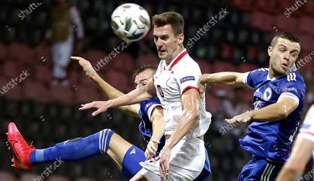 Polish player Arkadiusz Milik (L) in action against Bosnian's Armin hodzic (R) during the UEFA Nations League match between Bosnia  and Poland in Zenica, Bosnia and Herzegovina, 07 September 2020.