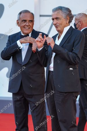 "Alberto Barbera and Bernard-Henri Levy walk the red carpet ahead of the movie ""The World To Come"" at the 77th Venice Film Festival on September 06, 2020 in Venice, Italy."