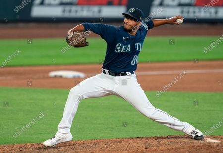 Stock Photo of Seattle Mariners reliever Aaron Fletcher delivers a pitch during a baseball game against the Texas Rangers, in Seattle. The Mariners won 8-4