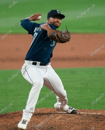 Seattle Mariners reliever Aaron Fletcher delivers a pitch during the ninth inning of a baseball game, in Seattle. The Mariners won 8-4
