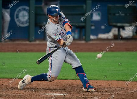 Texas Rangers' Nick Solak hits a RBI-single off of Seattle Mariners relief pitcher Aaron Fletcher during the ninth inning of a baseball game, in Seattle. The Mariners won 8-4