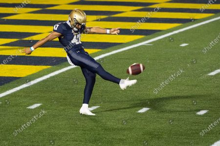 Stock Photo of Navy kicker Daniel Davies (47) punts during the second half of an NCAA college football game against BYU, in Annapolis, Md