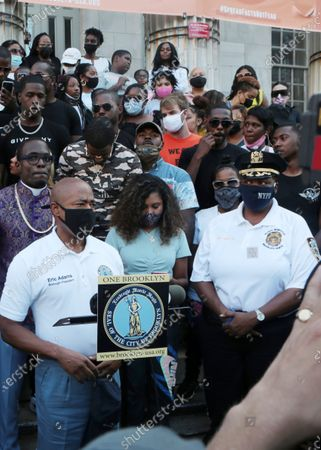 Bishop Lamor Whitehead, NYPD Patrol Borough Brooklyn North Chief Judith Harrison, Brooklyn Borough President Eric Adams, Media Personality Angela Yee and Recording Artist Frivio attend the Peace Walk from Brooklyn Borough Hall to Restoration Plaza in the Bedford Stuyvesant section of Brooklyn convened by Bishop Lamor Whitehead