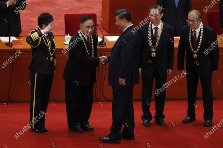 Chinese President Xi Jinping (C) shakes hands with traditional Chinese medicine (TCM) expert Zhang Boli (2-L), beside vaccine researcher and People's Liberation Army (PLA) major general Chen Wei (L), respiratory disease expert Zhong Nanshan (2-R) and head of Wuhan Jinyintan Hospital Zhang Dingyu (R) during a meeting commending role models in the country's fight against the COVID-19 epidemic at the Great Hall of the People (GHOP) in Beijing, China, 08 September 2020. The ceremony was held to honour people who were involved in the fight against the COVID-19.