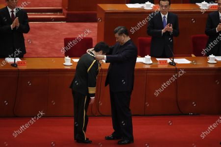 Chinese President Xi Jinping (R) awards medal to vaccine researcher and People's Liberation Army (PLA) major general Chen Wei (L) during a meeting commending role models in the country's fight against the COVID-19 epidemic at the Great Hall of the People (GHOP) in Beijing, China, 08 September 2020. The ceremony was held to honour people who were involved in the fight against the COVID-19.
