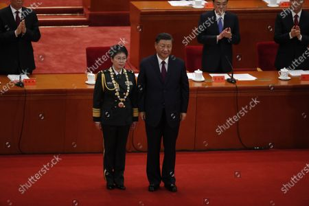 Chinese President Xi Jinping (R) poses with vaccine researcher and People's Liberation Army (PLA) major general Chen Wei (L) during a meeting commending role models in the country's fight against the COVID-19 epidemic at the Great Hall of the People (GHOP) in Beijing, China, 08 September 2020. The ceremony was held to honour people who were involved in the fight against the COVID-19.