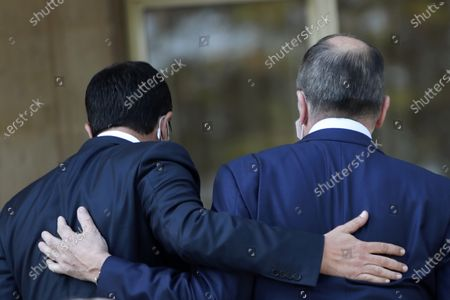 Russian Foreign Minister Sergey Lavrov, right, is greeting by his Cypriot counterpart Nikos Christodoulides as he arrives at the presidential palace for a meeting with Cypriot President Nicos Anastasiades in capital Nicosia, Cyprus, . Lavrov is paying an official visit to Cyprus amid heightened tensions over Turkey's search for energy resources in east Mediterranean waters where Greece and Cyprus claim as having exclusive economic rights