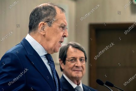 Russian Foreign Minister Sergey Lavrov, left, talks as the Cypriot President Nikos Anastasiades looks on prior to their meeting at the presidential palace in Nicosia, Cyprus, . Lavrov is paying an official visit to Cyprus amid heightened tensions over Turkey's search for energy resources in east Mediterranean waters where Greece and Cyprus claim as having exclusive economic rights