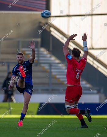 Calum Clark of Saracens attempts to block a kick by Robert du Preez of Sale Sharks; AJ Bell Stadium, Salford, Lancashire, England; English Premiership Rugby, Sale Sharks versus Sracens.