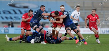 Stock Picture of Callum Hunter-Hill of Saracens is tackled by James Phillips and Dan du Preez of Sale Sharks; AJ Bell Stadium, Salford, Lancashire, England; English Premiership Rugby, Sale Sharks versus Saracens.