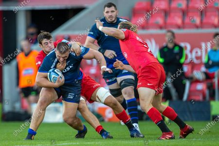 Valery Morozov of Sale Sharks is tackled by Callim Hunter-Hill of Saracens; AJ Bell Stadium, Salford, Lancashire, England; English Premiership Rugby, Sale Sharks versus Sracens.