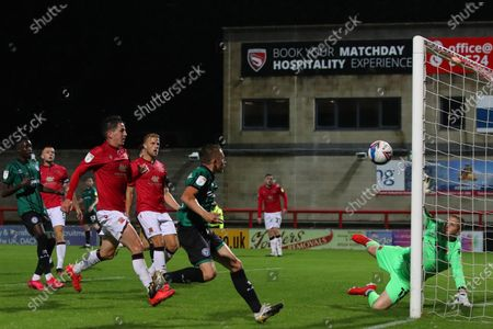 Stock Photo of Morecambe goalkeeper Mark Halstead saves the shot at goal by Lewis Bradley of Rochdale