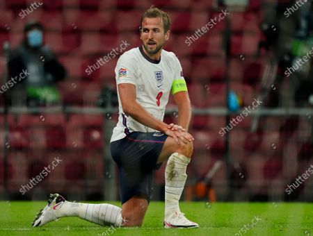 Stock Picture of Harry Kane of England reacts to a late chance at goal for it to be cleared off the line by Mathias Jorgensen of Denmark