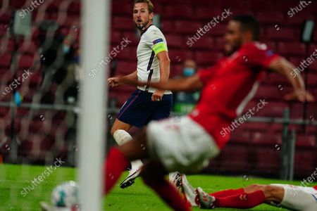 Harry Kane of England has a late chance at goal for it to be cleared off the line by Mathias Jorgensen of Denmark