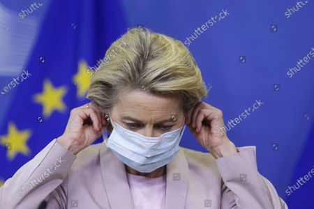 European Commission President Ursula von der Leyen removes her protective mask prior to making a press statement at EU headquarters in Brussels, . The European Union's executive commission has proposed European Commission vice-president Valdis Dombrovskis to take over the post of EU trade commissioner following the resignation of Ireland's Phil Hogan