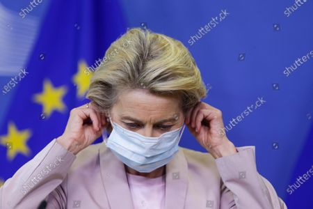 President of the European Commission Ursula Von der Leyen removes a protective face mask as she announces the replacement of Ireland's Commissioner Phil Hogan, whose portfolio will be taken by Latvia's Commissioner Valdis Dombrovskis, in Brussels, Belgium, 08 September 2020. This change comes as the Ireland's commissioner was obliged to resign after non compliance with coronavirus sanitary measures.