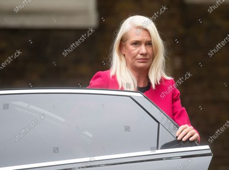 Amanda Milling, Minister without Portfolio, arrives for the Cabinet meeting which is being held in the Foreign Office.