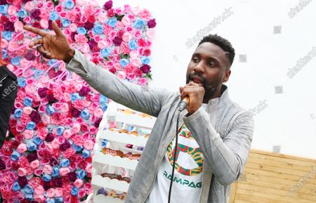 British rapper Kwazi Cort performs his new single 'Dough' at the launch of Dough Bakehouse in Beckenham