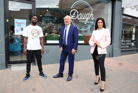 British rapper Kwazi Cort performs his new single 'Dough' in front of Lord Alan Sugar and Carina Lepore at the launch of Dough Bakehouse in Beckenham