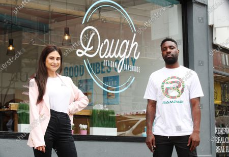 British rapper Kwazi Cort performs his new single 'Dough' in front of Carina Lepore at the launch of Dough Bakehouse in Beckenham