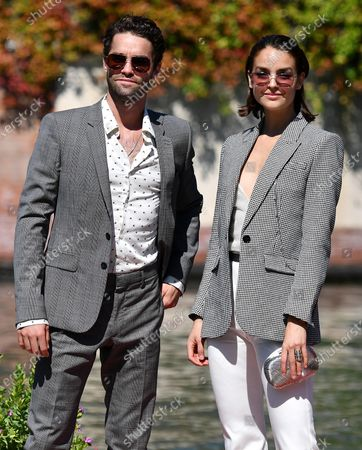 Maximilian Befort (L) and Luise Befort arrive at the Lido Beach for the 77th annual Venice International Film Festival, in Venice, Italy, 08 September 2020.The event is the first major in-person film fest to be held in the wake of the Covid-19 coronavirus pandemic. Attendees have to follow strict safety measures like mandatory face masks indoors, temperature scanners, and socially distanced screenings to reduce the risk of infection. The public is barred from the red carpet, and big stars are expected to be largely absent this year. The 77th edition of the festival runs from 02 to 12 September 2020.