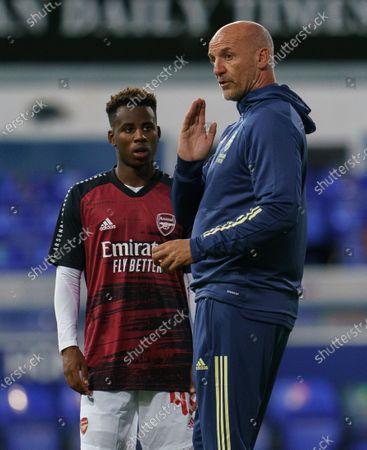 Arsenal U21 Head Coach Steve Bould talks to George Lewis of Arsenal U21