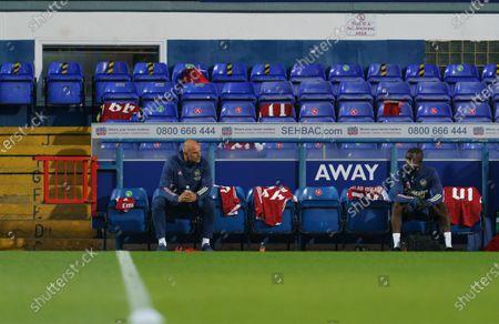 Arsenal U21 Head Coach Steve Bould sits on the bench