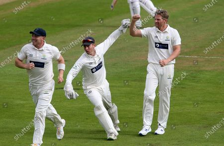 Timm van der Gugten of Glamorgan celebrates with Tom Cullen as Rob Yates is caught by Nick Selman.