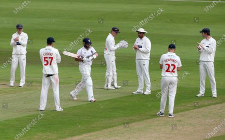 Ian Bell of  Warwickshire walks through a guard of honour from the Glamorgan players as he walks onto the field for his final first class innings.