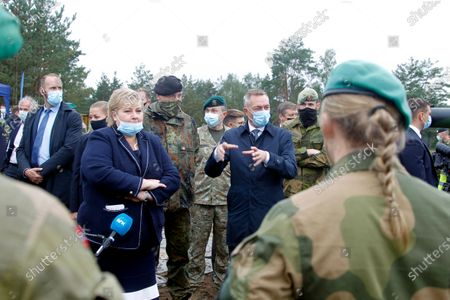 Norway's Prime Minister Erna Solberg (L) and Minister of Defence Frank Bakke Jensen (R) during their visit to Pabdrade Military base in Lithuania, 08 September 2020. Norwegian officials are on a one day visit to Lithuania.