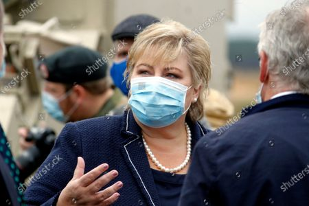 Norway's Prime Minister Erna Solberg gestures during her visit to Pabdrade Military base in Lithuania, 08 September 2020. Erna Solberg is on a one day visit to Lithuania.