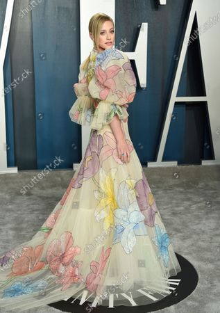 Lili Reinhart arrives at the Vanity Fair Oscar Party, in Beverly Hills, Calif. Reinhart turns 24 on Sept. 13