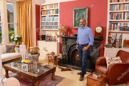 George Alagiah 'My Haven' - Living Room of his North London Home   Satchel which saved his life Music CD made by sons Matthew & Adam for George's 50th Birthday Father's tape measure Family photo with Fran & Sons Matthew & Adam when George received his OBE Professional award - Amnesty International Award Sculpture Award by Claire Curneen he received for his Novel Silver cigarette box given to his father-in-law by his fellow officers in RAF squadron Vintage clock passed on by his mother-in-law (kids used to love winding it up) Coconut Scraper used by his mother Good luck Items he takes when he has his Cancer treatment, his Dad's rosary, small Ganesh etc.