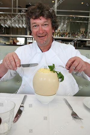 Chef Rowley Leigh eats an ostrich egg at Le Cafe Anglais