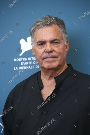 Amos Gitai poses for photographers at the photo call for the film 'Laila in Haifa' during the 77th edition of the Venice Film Festival in Venice, Italy