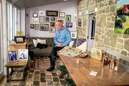 Johnnie Walker 'My Haven' - Garden Room of his Dorset Home 24.10.2019 Mother's Bush Radio (c.1960s) Kiss in the Car Licence from Radio Caroline Scrapbooks that Johnnie's mother compiled in 1960s of his career Silver cup from Led Zepplin - presented to Johnnie after introducing them at Earls Court in 1970s Tiggy & Johnnie wedding photo MBE photo Johnnie, Tiggy (Johnnie's kids) Beth & Sam at Buckingham Palace Photo of Elton John handing Johnnie his Sony Gold award. Sony Gold award Jeager-LeCoultre watch given to Johnnie on his 70th birthday by Tiggy Cartoon of Johnnie & Peter Kay after they recorded a car-share radio show as they drove around Bolton  Photo of Radio Caroline Boat Dog Darcey a working Cocker Spaniel