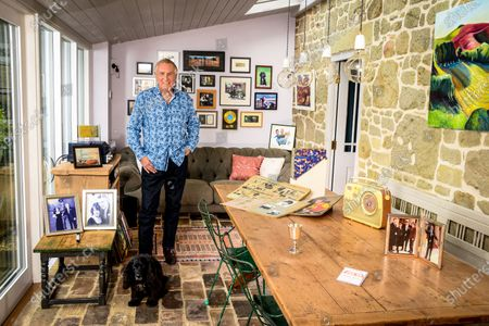 Stock Picture of Johnnie Walker 'My Haven' - Garden Room of his Dorset Home 24.10.2019 Mother's Bush Radio (c.1960s) Kiss in the Car Licence from Radio Caroline Scrapbooks that Johnnie's mother compiled in 1960s of his career Silver cup from Led Zepplin - presented to Johnnie after introducing them at Earls Court in 1970s Tiggy & Johnnie wedding photo MBE photo Johnnie, Tiggy (Johnnie's kids) Beth & Sam at Buckingham Palace Photo of Elton John handing Johnnie his Sony Gold award. Sony Gold award Jeager-LeCoultre watch given to Johnnie on his 70th birthday by Tiggy Cartoon of Johnnie & Peter Kay after they recorded a car-share radio show as they drove around Bolton  Photo of Radio Caroline Boat Dog Darcey a working Cocker Spaniel