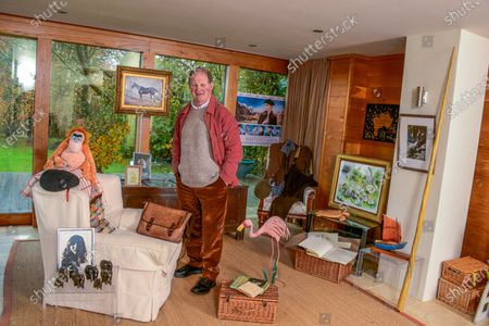 Stock Picture of Michael Morpurgo 'My Haven' - Writing Room of his Devon Home 22.11.2019 Photo of Clare MM kept with him all his Army days. (Clare talk him out of staying in the Army and going to raise pigs on the farm. MM would have come a Brigadier if he'd stayed) Elephants from a Nun who fell in love with MM (he has a lot of elderly lady admirers) Photo Clare with NT War Horse when it came to the village. Picture by Judith Kerr she gave to MM when had Cancer MM War Horse costume he wears on stage Painting of 'Top Thorn' The Real War Horse that inspired the book 'Waiting for Anya' movie poster Farm  Picture by Gerald Scarf (Farms for City Children link) Photo Farms for City Children Pink Flamingo model (Flamingo Boy book) His trademark red jacket and black beret (story behind these) Poems by Ted Hughes Turtle from daughter Ros Orangutang from publisher Re: 'Runnuing Wild' Boat from Scilly Isles Narwhale Tusk (made of plastic) Book MM won at school when he was 6 yrs old Large Wooden Truck from Clare's Dad dated 1666