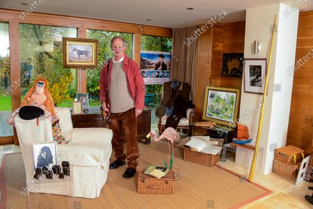 Stock Photo of Michael Morpurgo 'My Haven' - Writing Room of his Devon Home 22.11.2019 Photo of Clare MM kept with him all his Army days. (Clare talk him out of staying in the Army and going to raise pigs on the farm. MM would have come a Brigadier if he'd stayed) Elephants from a Nun who fell in love with MM (he has a lot of elderly lady admirers) Photo Clare with NT War Horse when it came to the village. Picture by Judith Kerr she gave to MM when had Cancer MM War Horse costume he wears on stage Painting of 'Top Thorn' The Real War Horse that inspired the book 'Waiting for Anya' movie poster Farm  Picture by Gerald Scarf (Farms for City Children link) Photo Farms for City Children Pink Flamingo model (Flamingo Boy book) His trademark red jacket and black beret (story behind these) Poems by Ted Hughes Turtle from daughter Ros Orangutang from publisher Re: 'Runnuing Wild' Boat from Scilly Isles Narwhale Tusk (made of plastic) Book MM won at school when he was 6 yrs old Large Wooden Truck from Clare's Dad dated 1666