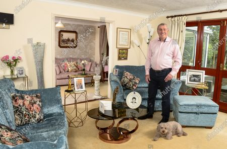 Peter Shilton 'My Haven'-Lounge of his Essex home 21.2.20201. Golf award and ornament2. Photo of Peter's Dad in the Navy3. His OBE medal, Photo with The Queen and the Queen's letter, 4. Nottingham Forest (Peter's club) replica of the European Cup in glass5. Wedding photo of Peter and his wife Steph in Barbados6. Ornament of Jazz Singer, Peter's wife sings Jazz.7. 125 limited edition plate detailing every game Peter played for England8. Christmas card from Sir Alf Ramsey, the 1966 England World Cup manager 9. Derby County picture celebrating Peter's record breaking number of appearances.10. England v Ireland 1963 Peter at 15 years old before her signed for Leicester City11. Football League Award 2013 long term merit award from the Football League for Peter's contribution to football12. Peters dog Charlie (CockerPoo)